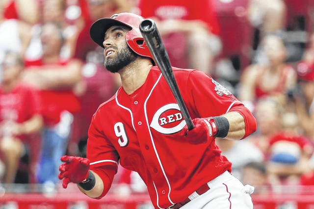 Cincinnati Reds shortstop Jose Peraza watches the flight of his grand slam home run against Milwaukee Brewers relief pitcher Aaron Wilkerson on Sunday.