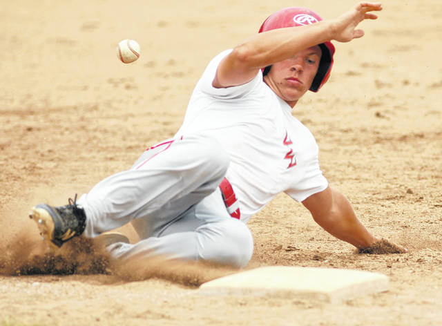 Van Wert's T.J. Reynolds slides safetly into third after lacing a double and then taking the base on the throw. Reynolds went 3 for 4 in an ACME League district game against Elida on Sunday.