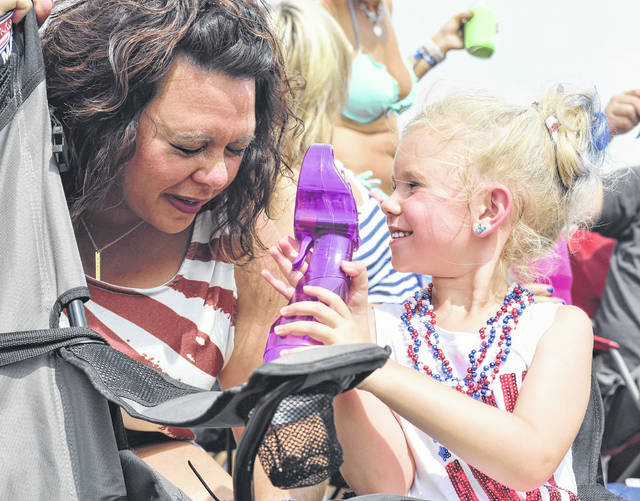 Harley Thompson, right, 5, sprays her mom, Brittany Runner, both of Union City, with water at Country Concert Thursday, July 5. Harley is also the daughter of Lance Thompson.