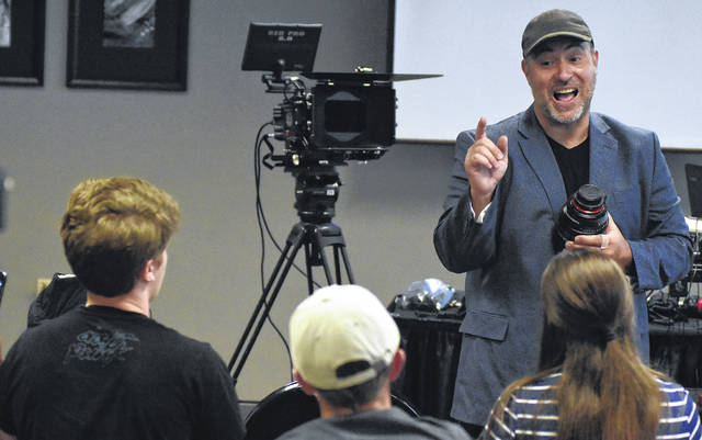 "Aaron Martin, a director with Music and Motion Pictures from San Diego, California instructs young film makers about a camera lens during (SIAFB) Student Integrated Arts and Acting Filmmaker Boot Camp 2018 at Veterans Memorial Civic Center in Lima. Martin is best known for his work as the composer for hits like ""Passion of the Christ,"" ""Avatar,"" ""Cars,"" ""Batman Begins"" and more."