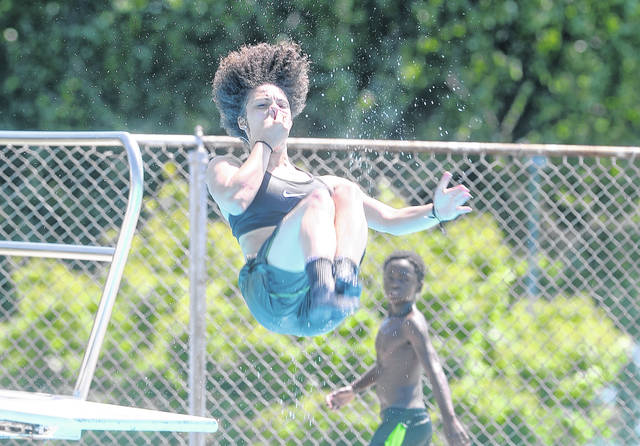 Asia Frank takes a dive in the pool on Friday at Schoonover Pool, a facility maintained and funded by the City of Lima.