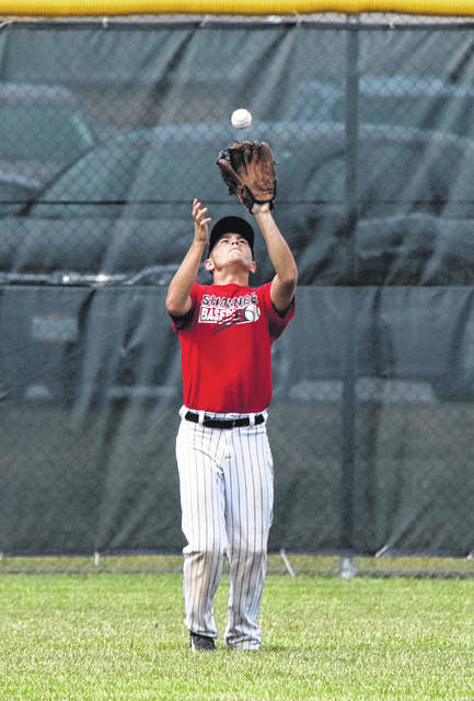 Shawnee's Joey Azzarrello pulls in a fly ball during Tuesday night's ACME district game at Lima Central Catholic.