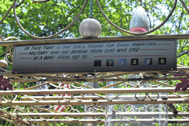 A sign at the Temple of Tolerance near Wapakoneta explains the symbolism of a tube containing shell casings.
