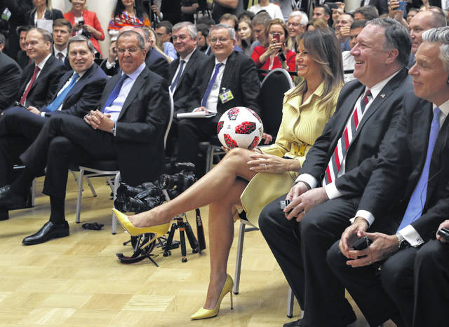 U.S. First Lady Melania Trump holds the soccer ball given to the Trumps as a gift from Russian President Vladimir Putin. (AP Photo/Pablo Martinez Monsivais)