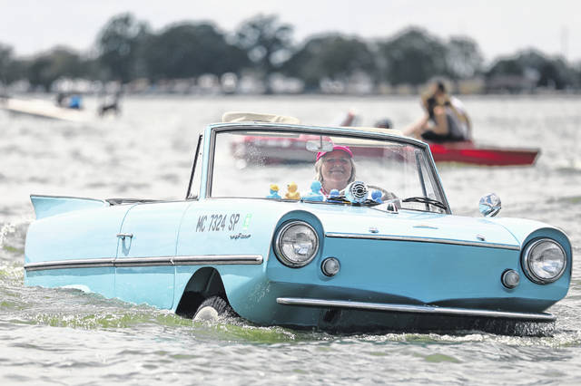 Deana Gentz Reiner smiles during the largest gathering of Amphicars held at the Celina Lake Festival Saturday in West Bank State Park.