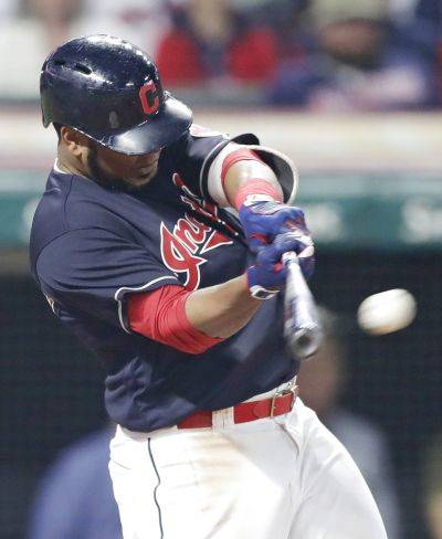 The Indians' Edwin Encarnacion hits a one-run double off Oakland relief pitcher Emilio Pagan in the seventh inning of a Friday night's game in Cleveland. AP photo