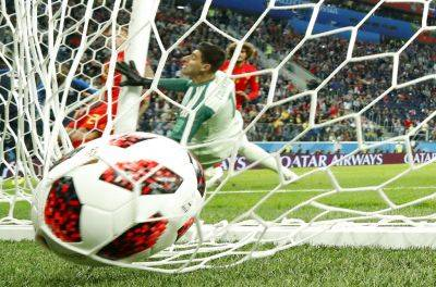 Belgium goalkeeper Thibaut Courtois is unable to prevent a shot by France's Samuel Umtiti (not pictured) from going to the back of the net for a goal during Tuesday's World Cup semifinal in St. Petersburg, Russia.
