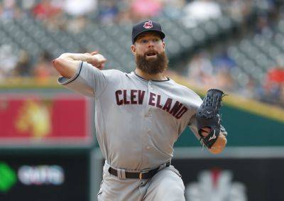 Cleveland Indians pitcher Corey Kluber throws against the Detroit Tigers in the first inning of Sunday;s game in Detroit. (AP photo)
