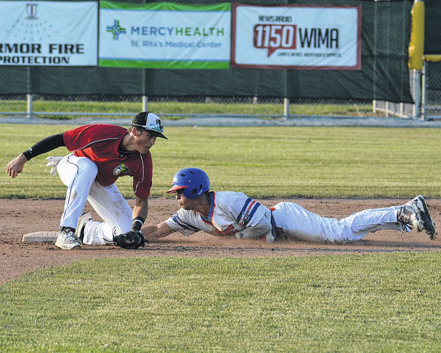 Lima Loco Michael Diffley slides safely into second base against the Saginaw Sugar Beets' Ryan Robinette during Tuesday night's game at Simmons Field.