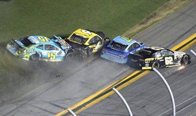 Ross Chastain (15), Trevor Bayne (6), Ricky Stenhouse Jr. (17) and Brendan Gaughan (62) collide along the front stretch during Saturday night's NASCAR Cup Series race at Daytona International Speedway in Daytona Beach, Fla. (AP photo)