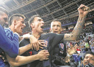 Mario Mandzukic, center, celebrates after scoring Croatia's second goal during Wednesday's World Cup semifinal against England in Moscow.