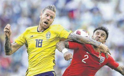 Sweden's Pontus Jansson, left, challenges England's Kyle Walker for the ball during a World Cup quarterfinal Saturday in Samara, Russia.