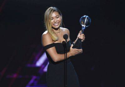 Snowboarder Chloe Kim accepts the award for best female athlete at Wednesday night's ESPY Awards at Microsoft Theater in Los Angeles. (AP photo)
