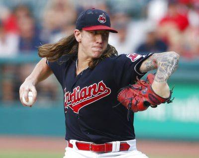 """Pitcher Mike Clevinger says about the Indians that """"everybody is a bunch of professionals who handle their own business in the right way, and you don't want to be that odd man out."""" AP photo"""