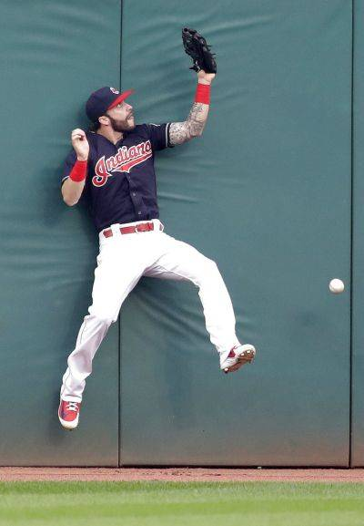 The Indians' Tyler Naquin is unable to retrieve a ball hit by Pittsburgh's Corey Dickerson during Tuesday's game in Cleveland. Dickerson hit a two-run triple. (AP photo)