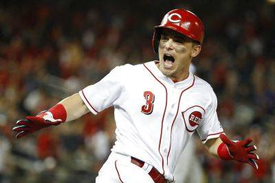 The Cincinnati Reds' Scooter Gennett celebrates his two-run homer in the ninth inning during Tuesday night's Major League Baseball All-star Game in Washington. (AP Photo)