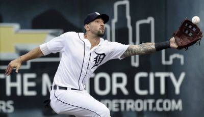 Tigers right fielder Nicholas Castellanos catches a foul ball during Saturday night's game against Cleveland in Detroit. (AP photo)
