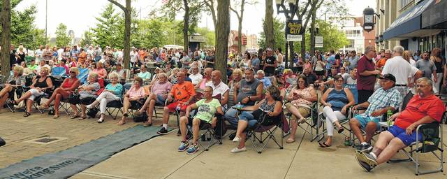 A crowd fills the northwest corner of the square for Rally in the Square.