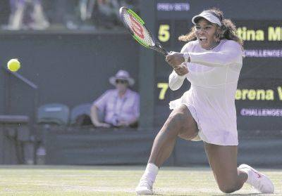 Serena Williams hit a return durning her Friday women's singles match against Kristina Mladenovic at the Wimbledon Tennis Championships in London.