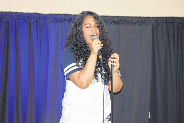 Victoria Phillips, 12, of Lima performs at Saturday night's talent show at the Bradfield Community Center.