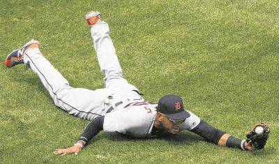 Detroit's Victor Reyes is able to reach a fly ball in time to record an out during Wednesday's game in Kansas City.