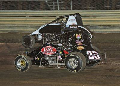 Kyle Simon (23) makes the feature winning pass on Dallas Hewitt in the closing laps of the non wing sprint feature Saturday night at Waynesfield Raceway Park.