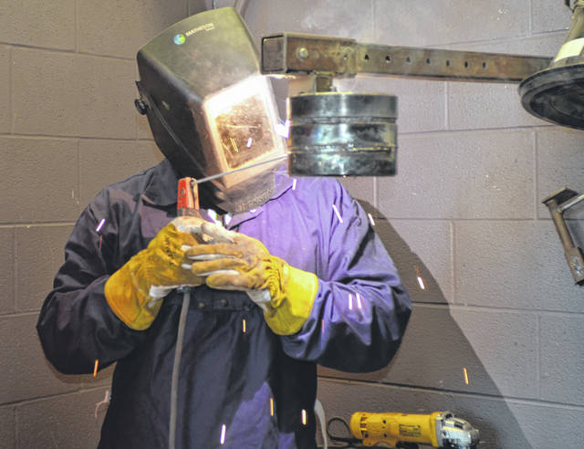 Apollo Career Center student Lucas Perkins welds pipes during a class at the Apollo Career Center.