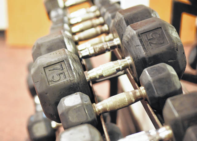 Weights at the YMCA await the next visitor.