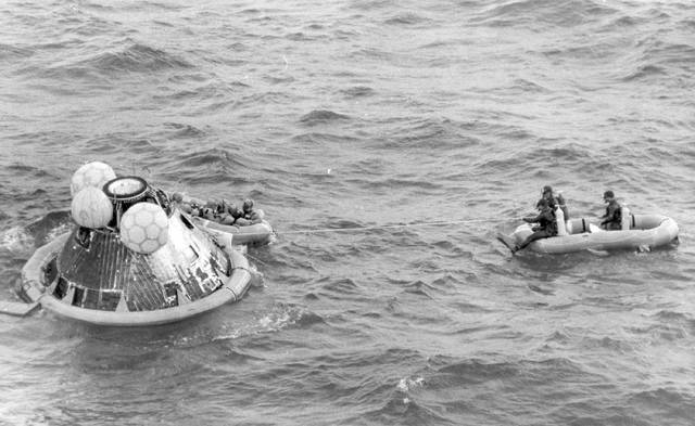 In this July 24, 1969, file photo, the Apollo 11 command module lands in the Pacific Ocean and the crew waits to be picked up by U.S. Navy personnel after an eight-day mission to the moon. A solid-gold replica of the Apollo 11 lunar module stolen in July 2017 from the Wapakoneta museum honoring the late Neil Armstrong has yet to be recovered, a year later.