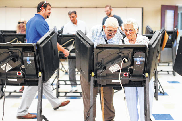 Voters cast their ballots among an array of electronic voting machines in a polling station at the Noor Islamic Cultural Center, Tuesday in Dublin. Two-term state Sen. Troy Balderson, is fighting off a strong challenge from Democrat Danny O'Connor, a 31-year-old county official, in a congressional district held by the Republican Party for more than three decades.
