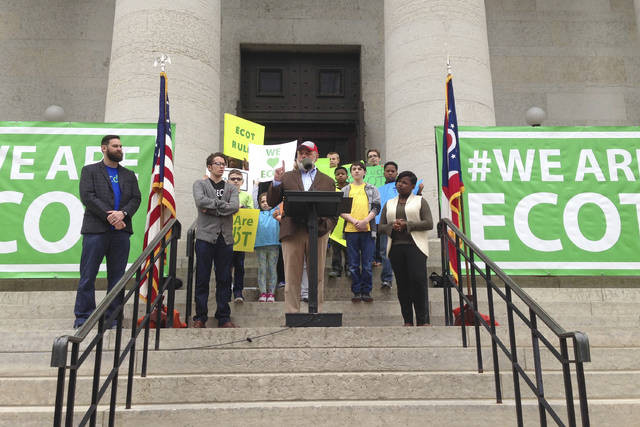 FILE – In this May 9, 2017, file photo, Bill Lager, center in cap, co-founder of Ohio's largest online charter school, the Electronic Classroom of Tomorrow or ECOT, speaks to hundreds of supporters during a rally outside the Statehouse in Columbus, Ohio. The Supreme Court of Ohio ruled Wednesday, Aug. 8, 2018, that the state had authority to calculate ECOT's funding using student participation data rather than only enrollment, in the latest blow to the now-dismantled online charter school. (AP Photo/Julie Carr Smyth, File)