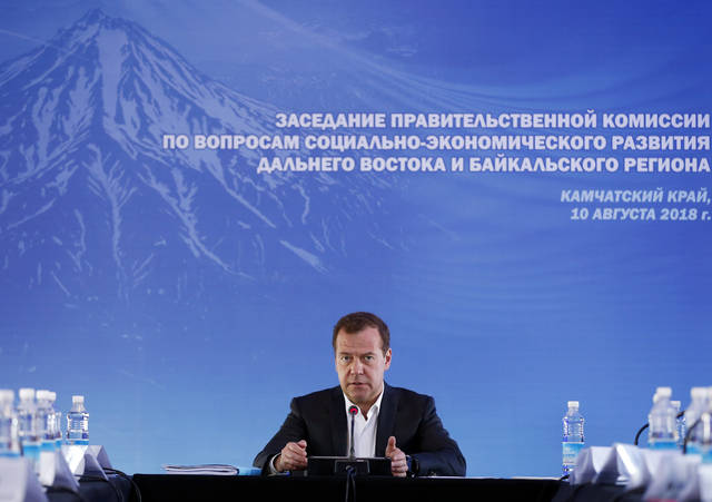 """Russian Prime Minister Dmitry Medvedev speaks during a meeting in Kamchatka Peninsula region, Russian Far East, Russia, Friday. Russia's prime minister sternly warned the United States on Friday against ramping up sanctions, saying that Moscow will retaliate with economic, political and unspecified """"other"""" means."""