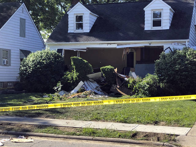 This photo provided by WEWS-TV in Cleveland shows the home in South Euclid, Ohio, where two brothers were found dead of self-inflicted gun shot wounds Aug. 11. Kevin Nietert, police chief in the Cleveland suburb of South Euclid says he can only speculate why 31-year-old Michael Warn and 29-year-old Mark Warn would have killed 59-year-old Dr. Richard Warn at the podiatrist's home in Beachwood, an upscale Cleveland suburb. Richard Warn was found dead by his wife Aug. 9. A SWAT team went to the brothers' South Euclid home the next night with detectives to serve a search warrant. The brothers opened fire and were found dead of self-inflicted gunshot wounds around 12 hours later.