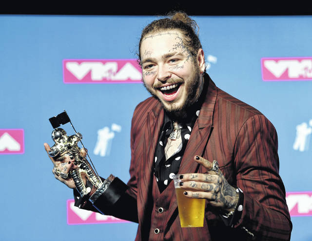 """Post Malone poses with the award for song of the year for """"Rockstar"""" in the press room at the MTV Video Music Awards at Radio City Music Hall on Monday. His private jet needed an emergency landing after two tired blew on takeoff."""