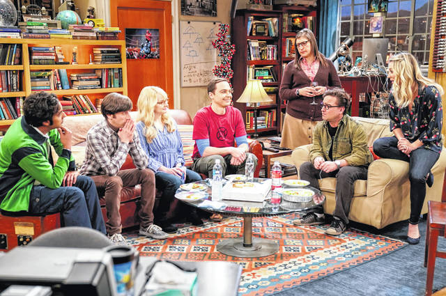 """This image released by CBS shows, from left, Kunal Nayyar, Simon Helberg, Melissa Rauch, Jim Parsons, Mayim Bialik, Johnny Galecki and Kaley Cuoco appear in a scene from the long-running comedy series """"The Big Bang Theory."""" The popular series will end in 2019."""