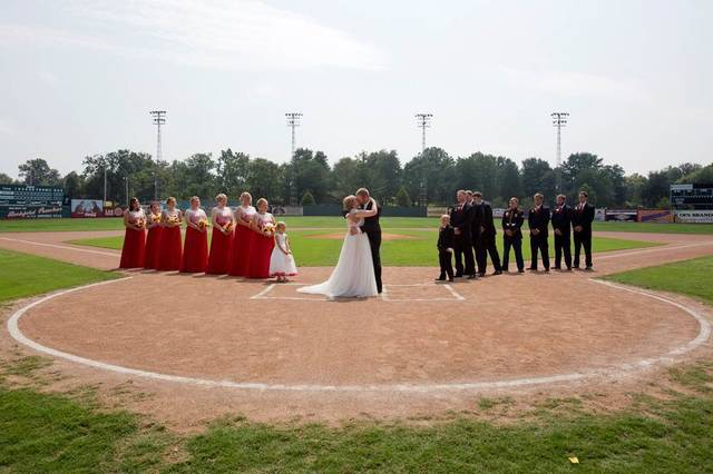 "Kristopher Weisheit and Brittany Birk took their vows Saturday, Aug. 25, 2018,  from home plate at League Stadium in Huntingburg, Ind., while their groomsmen and bridesmaids lined up, respectively, along the first and third baselines. The stadium is featured in the 1992 movie about a women's baseball league during World War II that starred Tom Hanks and Madonna. In one scene, Hanks' team manager character tells one of his players: ""there's no crying in baseball.""  (Nic Antaya/The Herald via AP)"
