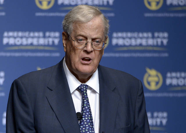 """David Koch speaks in 2013 in Orlando, Fla. The political network created by the billionaire Koch brothers plans to support eight House Republicans, including Ohioan Steve Chabot. The sprawling conservative organization on Thursday pledged its financial resources and army of activists to help re-elect several vulnerable congressmen deemed """"principled"""" conservatives."""