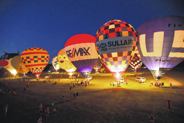 This photo of a past BalloonFest shows the balloons lighting up the night sky.