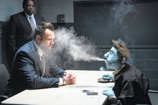 "This image released by STX Entertainment shows Joel McHale in a scene from ""The Happytime Murders."""
