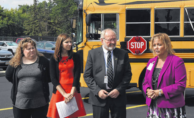 Cindy Nelson, Lima AAA store manager, left, Kimberly Schwind, Mayor David Berger and Jill Ackerman, Lima schools Superintendent hold a news conference at West Middle School on Wednesday morning.