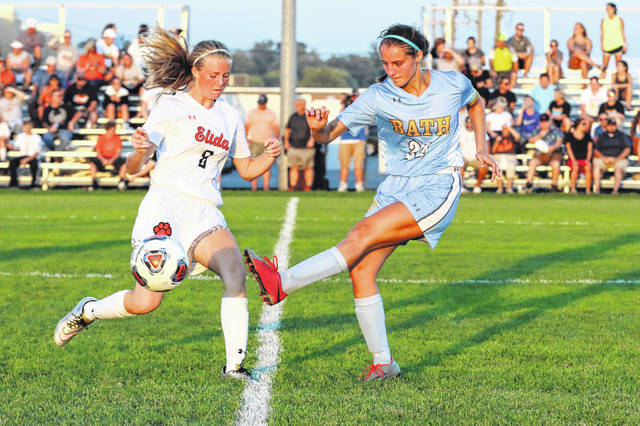 Bath's Tori Dackin, right, gets off a pass ahead of the block attempt by Elida's Morgan Klett during Tuesday night's match at Bath.