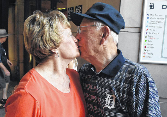 Bob Stolly of Lima, gets a kiss from his wife, Mary Margaret, before heading his way to the field at Comerica Park in Detroit to throw out the first pitch.