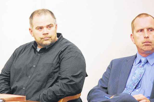Matthew Burton, left, former maintenance supervisor at Elida schools, was sentenced Monday to four years on probation and 85 days in jail — one day for each $1,000 he stole from the district — during a hearing in Allen County Common Pleas Court. At right is his attorney, Kenneth Rexford.