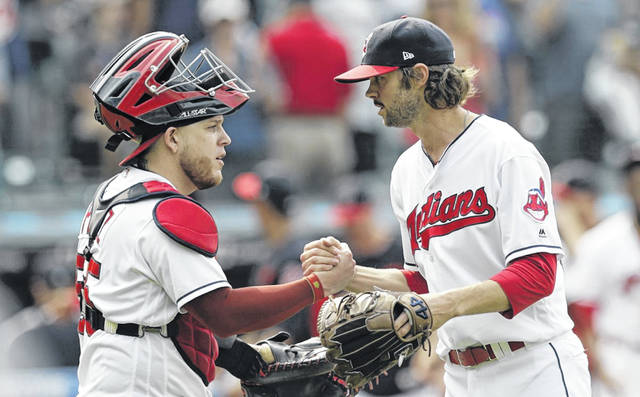 Cleveland Indians catcher Roberto Perez, left, and relief pitcher Adam Cimber celebrate after the Indians defeated the Baltimore Orioles 8-0 on Sunday.