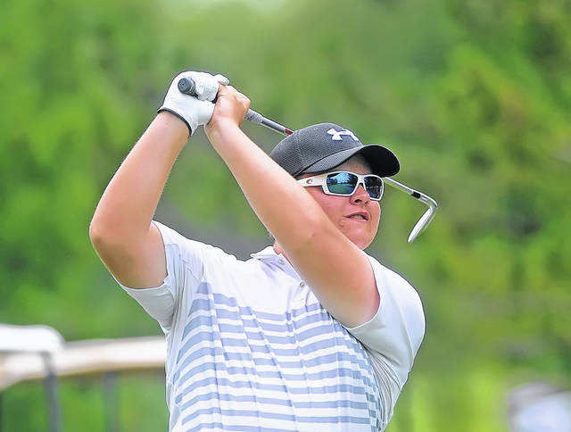 Spencerville's Ethan Harmon watches his tee shot on the 13th hole during Tuesday's The Allen East/Colonial Golfers Club tournament in Harrod.
