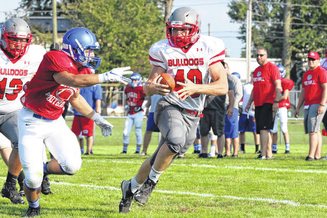 Columbus Grove's Garrett Nemire (40) shows off his moves during a scrimmage earlier this year. Nemire rushed for more than 800 yards last season.