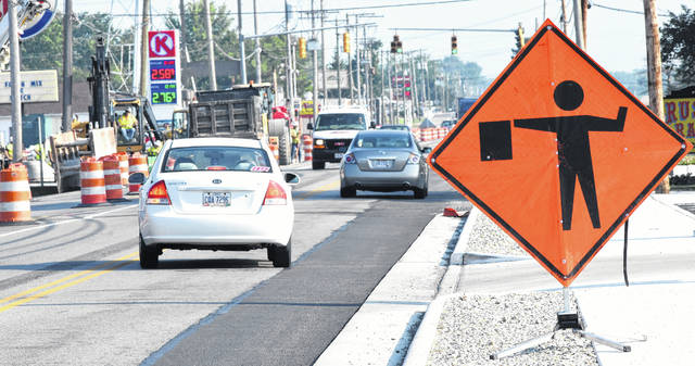 Commuters come into Lima through a construction zone on state Route 65.