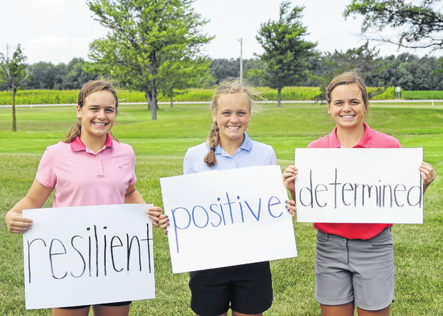 Lima Central Catholic's Erin, left, Meghan, center, and Mary Kelly Mulcahy are a formidable team on the golf course but still have their own unique personalities. The Lima News asked each to write down a word that best describes them after completing their rounds at the recent Lima Junior Golf Association McDonald's Series Weisenburger Builders Open at Country Acres Golf Club near Kalida.