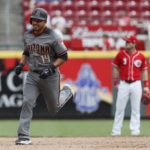 Diamondbacks use five home runs to avoid sweep by Reds