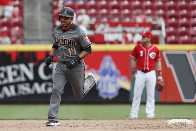 Arizona Diamondbacks' Eduardo Escobar runs the bases after hitting a two-run home run off Cincinnati Reds relief pitcher Keury Mella in the ninth inning Sunday.